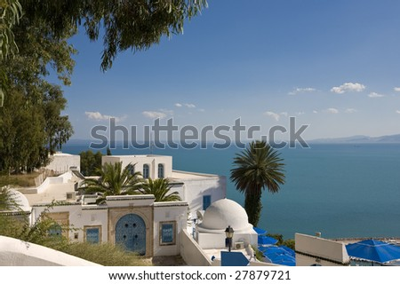 Tunisia. Sidi Bou Said - typical building with white walls, blue doors and windows. - stock photo