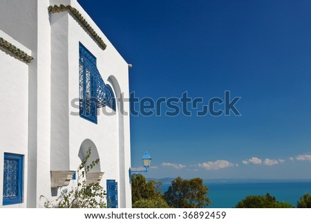Tunisia. Sidi Bou Said - typical building with white walls, blue doors and windows - stock photo