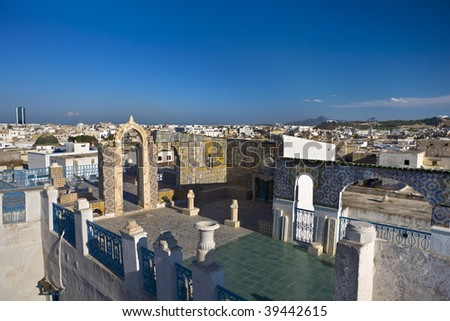 Tunisia. Tunis - old town (medina). Terrace of Palais d'Orient with ornamental arches and wall covered tiles - stock photo