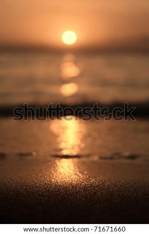 Tunisian sunset at the sandy beach - stock photo