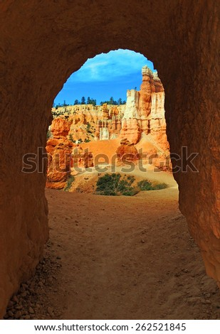tunnel along the queen's garden trail in bryce canyon national park, utah  - stock photo