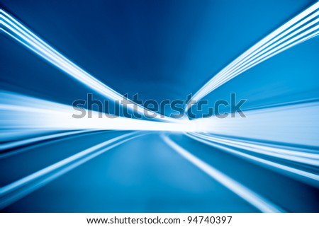 tunnel background with light trails - stock photo
