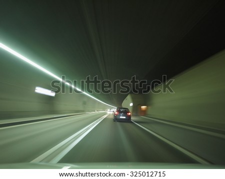 tunnel car motion blur night traffic fast - stock photo