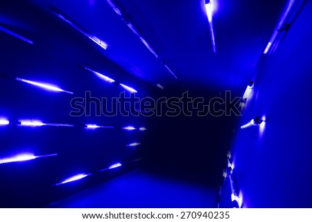 tunnel going to the dark with blue LED lighting  - stock photo