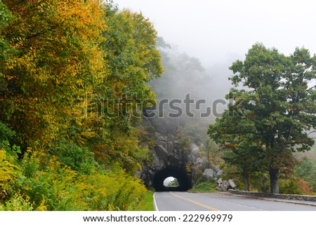 Tunnel in foggy Autumn morning in Shenandoah National Park, VA - stock photo
