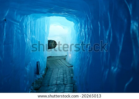 Tunnel in the ice inside Rhone glacier, Switzerland - stock photo