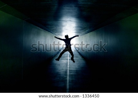 Tunnel of Hope- man jumping inside a tunnel