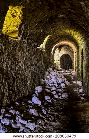 Tunnel of the medieval Castle of Parga in Greece. - stock photo