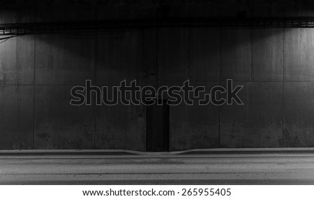 Tunnel road area, black door in the wall - stock photo