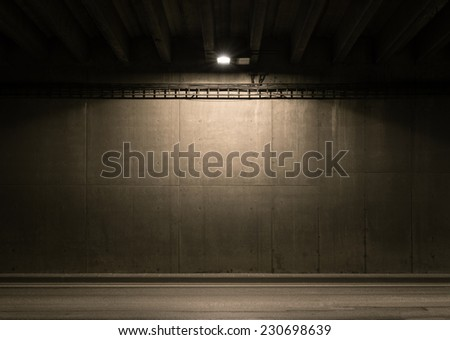Tunnel road area with spotlight on the wall - stock photo