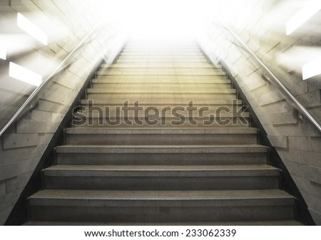 tunnel Staircase going up to the light - stock photo