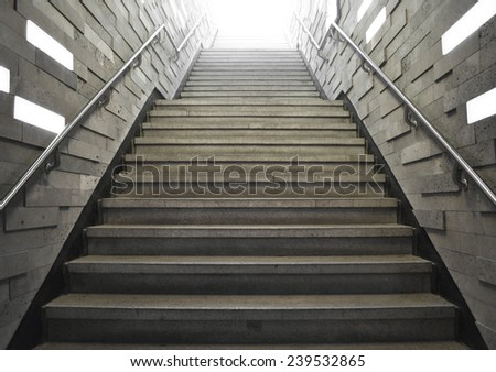 tunnel Staircase going up to the soft light - stock photo