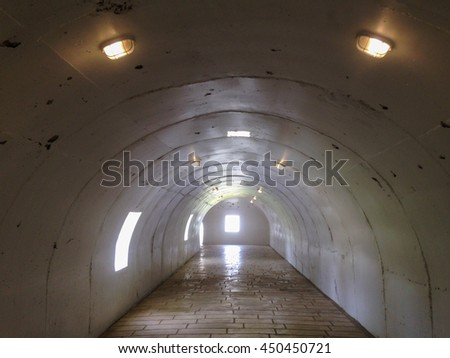 tunnel underground with lighting.
