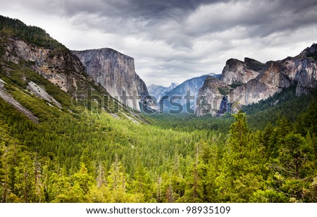 tunnel  viewpoint at yosemite national park with heavy overcast and bright green fir forest - stock photo