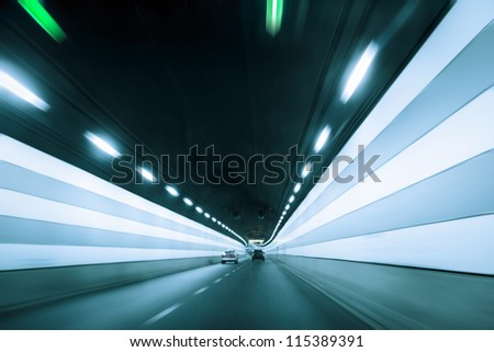 tunnel with dynamic background in shanghai - stock photo