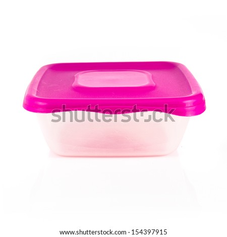 tupperware with pink cover over white background - stock photo