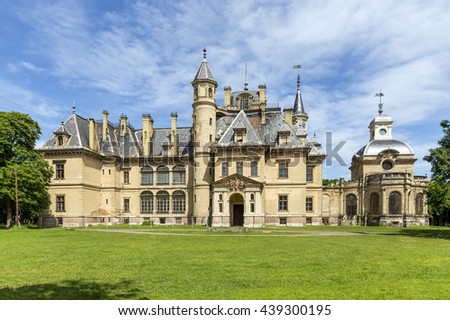 TURA, HUNGARY - MAY 22, 2015: The Schossberger castle in Tura, a town in Pest County, Hungary. Tura lies between the Great Plain and Matra Hills, in the Galga Valley.