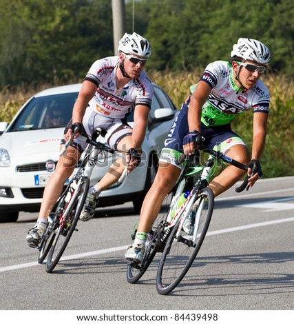 TURBIGO, ITALY - SEP 10: The cyclists riding by at the bicycle race during the 45° Memorial Marcoli on September 10, 2011 in Turbigo