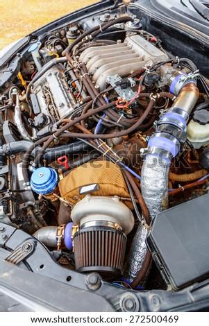 Turbine closeup of charged powerful car engine - stock photo
