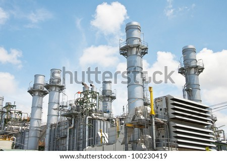 Turbine generator in power plant with blue sky