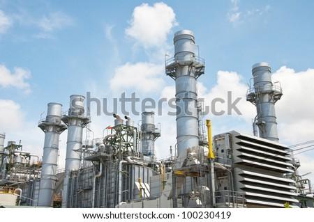 Turbine generator in power plant with blue sky - stock photo
