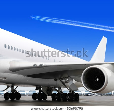 turbine of big passenger plane that waiting for departure in airport - stock photo