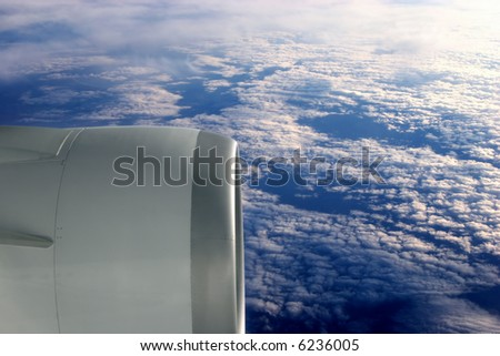 Turbines above the clouds - stock photo