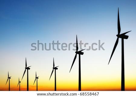 Turbines at Sunset - stock photo