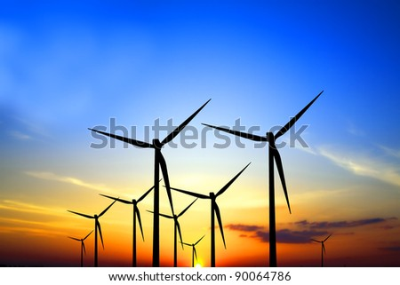 Turbines at sunset - stock photo