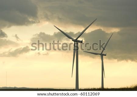 Turbines on a wind farm at sunset in Scottish summer - stock photo