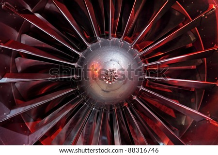 Turbo-jet engine of the plane, close up in the red light - stock photo