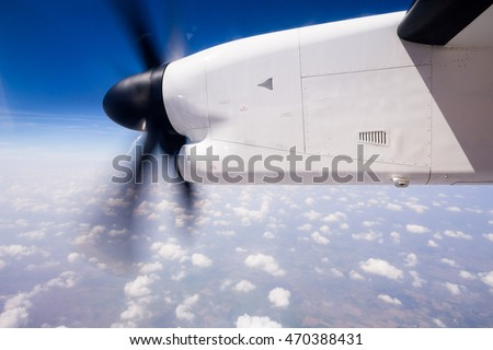 turboprop propeller of plain seen through the window during flig