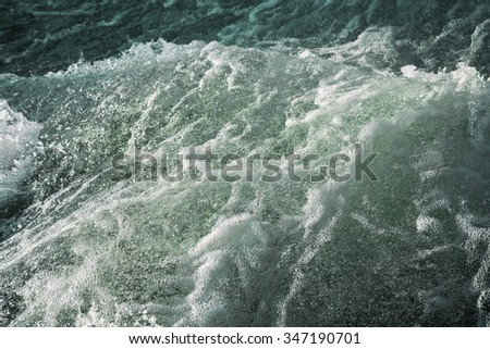 Turbulent water of a river as background - stock photo