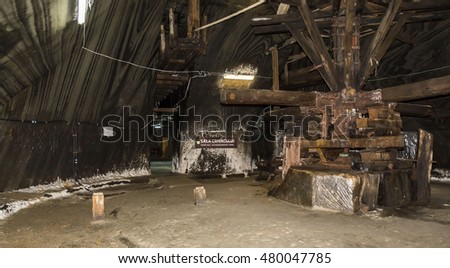 TURDA, ROMANIA - SEPTEMBER 6, 2016. Underground salt mine in Turda ,popular attraction for many tourists,Transylvania, Romania. Crivac Room, ancient wooden technology .