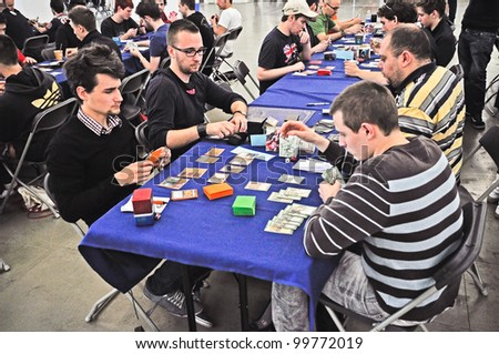 TURIN - APRIL 1: Unidentified players of Magic The Gathering, a fantasy card game, during the tournament Grand Prix Turin on April 1, 2012 Turin, Italy. - stock photo