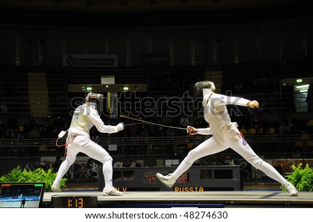 TURIN - FEB 7: Women Foil World Cup, team tournament final match Italy vs Russia on February 7, 2010 in Turin, Italy. - stock photo