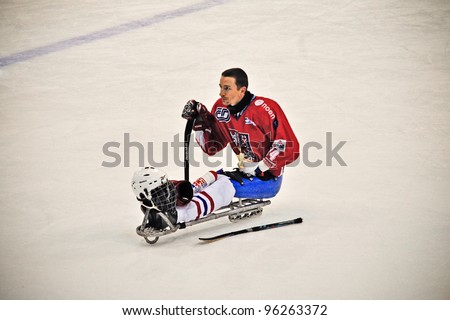 "TURIN - FEBRUARY 25: Energy break of unidentified Czech player during qualification's match Italy Vs Czech Republic. Ice Sledge Hockey tournament ""Città di Torino"" on February 25, 2012 Turin, Italy. - stock photo"
