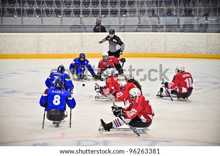 "TURIN - FEBRUARY 25: Faceoff between Italy and Czech Republic teams during qualification's phase of Ice Sledge Hockey tournament ""Città di Torino"" on February 25, 2012 Turin, Italy."