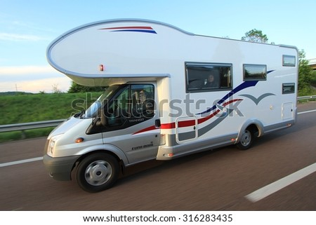 TURIN, FRANCE - MAY 5, 2011 - Motorhome at the interurban road in nothern France on May 5 2011. - stock photo