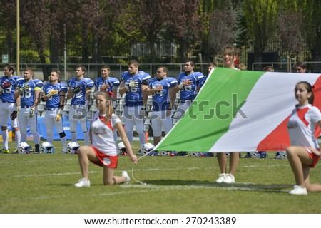 TURIN, ITALY - APRIL 12, 2015: America football U19 national team stands at anthem.  Italian U19 team win the qualifying match with Spain for European championship, in the Nebiolo Stadium in Turin. - stock photo