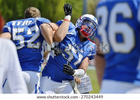 TURIN, ITALY - APRIL 12, 2015: BALDI Julian (left) and GIRIBALDI Nicholas (right) cheer before Italy vs Spain U19 american football match, in the Nebiolo Stadium in Turin. - stock photo