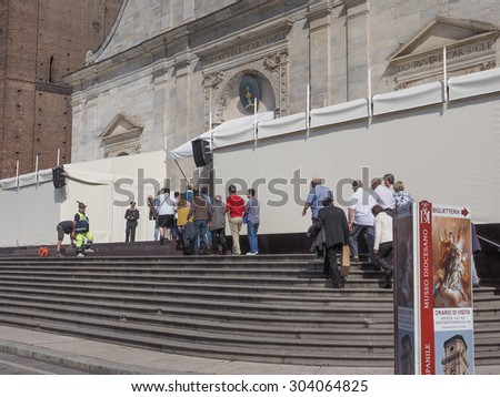 TURIN, ITALY - APRIL 22, 2015: People queueing in front of Turin cathedral to visit the Holy Shroud of Turin