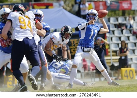 TURIN, ITALY - APRIL 12, 2015: Quarterback BIANCOLELLA Giovanni (right) launches during Italy vs Spain U19 american football match, in the Nebiolo Stadium in Turin. - stock photo