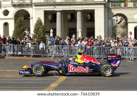 TURIN ITALY - APRIL 30: Red Bull F1 Showrun Torino 2011. Mark Webber for the city streets in a show. Turin Italy April 30.2011 - stock photo
