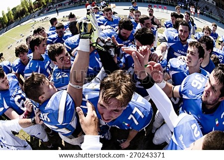 TURIN, ITALY - APRIL 12, 2015: TURIN, ITALY - APRIL 12, 2015: America football national team of Italy cheers after match vs Spain U19, in the Nebiolo Stadium in Turin.
