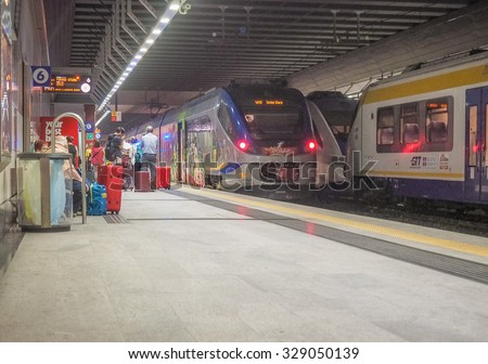 TURIN, ITALY - AUGUST 05, 2015: People waiting for a train on a platform at the new Torino Porta Susa railway station - stock photo