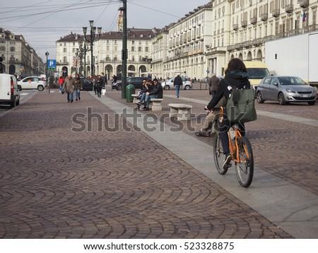TURIN, ITALY - CIRCA NOVEMBER 2016: Pedestrians and cyclist in Piazza Vittorio Emanuele II square