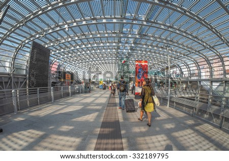 TURIN, ITALY - CIRCA SEPTEMBER, 2015: Travellers in Torino Porta Susa railway station which is the main central station seen with fisheye lens - stock photo
