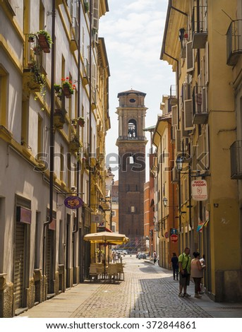 TURIN, ITALY ,EUROPE - JUNE 29, 2015. Street in the historical center of Turin. At the background is the Bell tower of the Holy Shroud cathedral, resting place of the Shroud of Turin. - stock photo