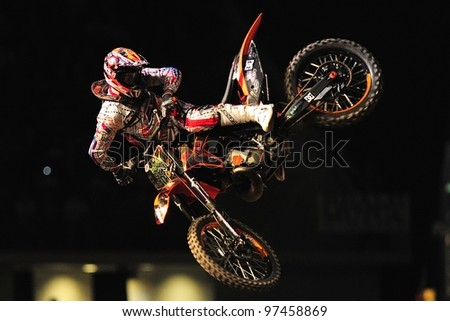 TURIN, ITALY - FEB 03: Massimiliano BIANCONCINI (ITA) performs trick during the 2012 FIM Mx Freestyle World Championship on February 03, 2012 in Turin, Italy. - stock photo